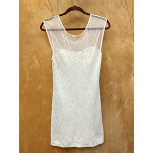 Urban Outfitters Ivory sleeveless body con mini